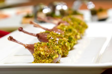 scrumptious: Pistachio crusted quail ballotine served with sweet potato and goat cheese mousse