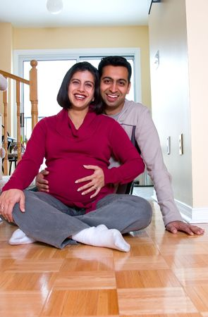 A happy East Indian couple expecting a  photo