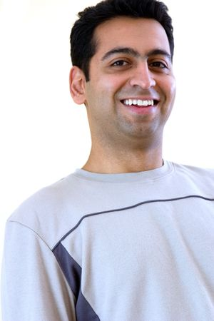 Profile of a laughing east indian man
