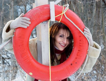 life preserver: A young model playfully poses witha  life preserver