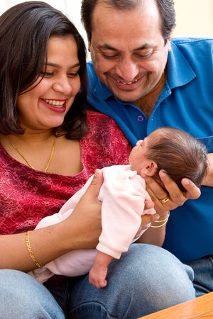 indian family: A young couple with their baby Stock Photo