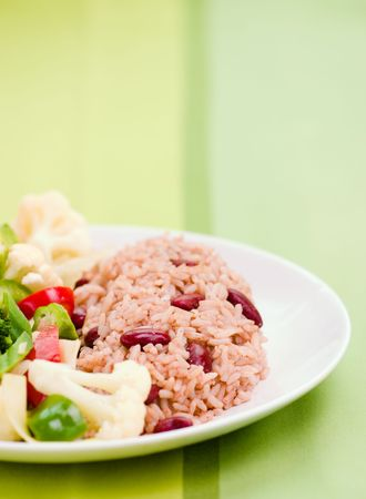 scrumptious: Caribbean style rice cooked with red kidney beans served with fresh garden vegetables. Shallow DOF.