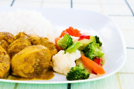 delectable: Curried chicken - Caribbean style served with rice and vegetables.  Shallow DOF.