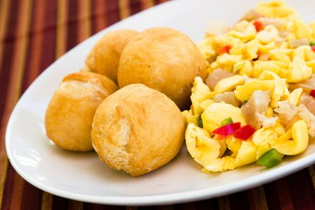 Caribbean style vegetable dumpling (ackee) served with saltfish or codfish. Stock Photo - 962083