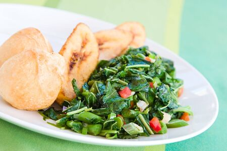 mouthwatering: Speciality caribbean dish of callaloo (spinach) served with fried dumplings