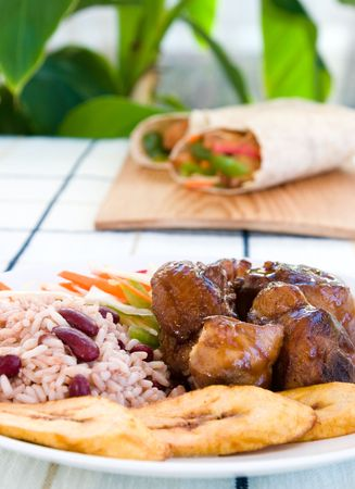 jamaican: Stewed chicken - Caribbean style served with rice and vegetables.  Shallow DOF.