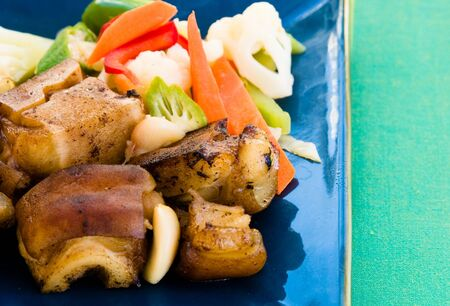 Cows foot - Caribbean style served with fresh garden vegetables. Shallow DOF. Stock Photo