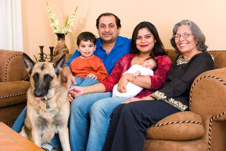 grandmother grandchild: An East-Indian family sits in their living room Stock Photo