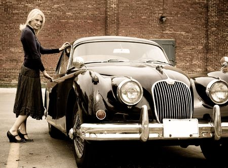 luxuries: A beautiful blond woman getting into a classic car