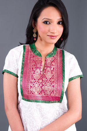 tunic: A model wearing a tunic with traditional Indian brocade embroidery