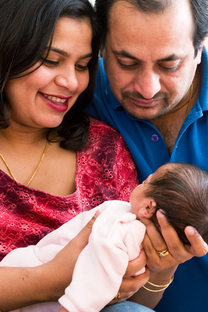 A young couple with their baby Stock Photo