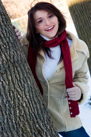 A playful young woman outdoors in the snowfall photo