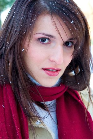 Young woman outdoors in the snowfall photo