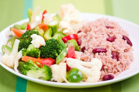 mouthwatering: Caribbean style rice cooked with red kidney beans served with fresh garden vegetables. Shallow DOF.