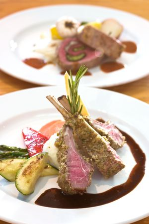 enticing: Crusted lamb chops served with zucchini and peppers