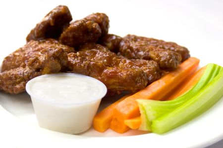 enticing: Spicy chicken wings served with carrots and celery and a dipping sauce