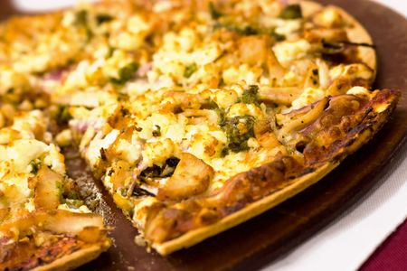 enticing: Three cheese pizza on a platter