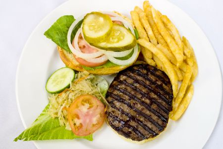 Open burger served with fries and coleslaw photo