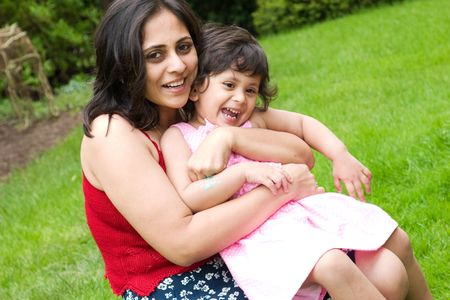 A mother plays with her daughter in the backyard Stock Photo - 3205252