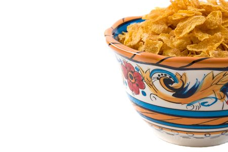 Bowl of corn flakes isolated on white. Part of the breakfast series images.