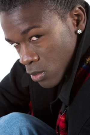 fashionably: A fashionably dressed african american man glances sideways