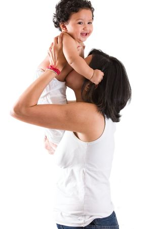 An east indian mother plays with her baby