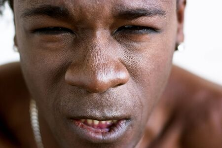 An african american man grimaces in rage