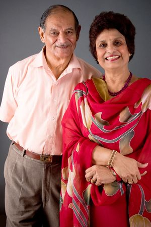indian couple: Portrait of a happy elderly East Indian couple Stock Photo