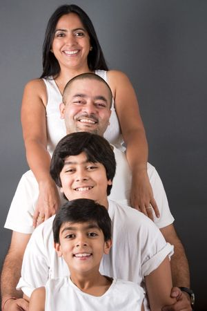 An Indian family all pose together ina  fun setting Stock Photo