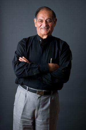 Portrait of a happy elderly East Indian businessman