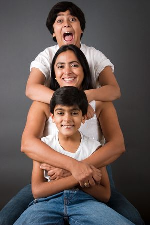 An Indian mother with her two sons Stock Photo