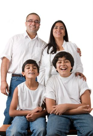 An Indian family all pose together in a fun setting