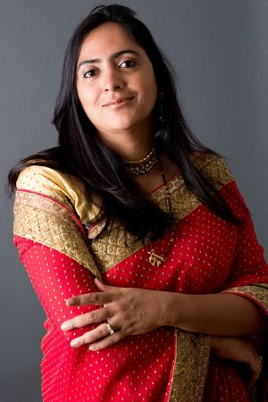 Portrait of an East Indian woman against a gray backdrop