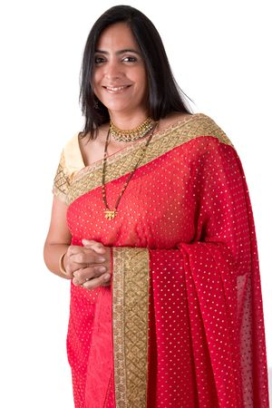 Portrait of an East Indian woman wearing a sari isolated against a white backdrop