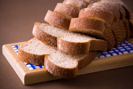 A loaf of sliced whole wheat bread Archivio Fotografico