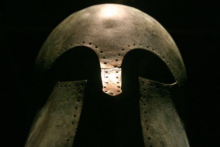 Dramatic shot of a medieval warriors helmet photo