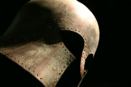 Dramatic profile shot of a medieval warrior's helmet