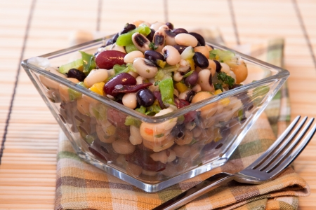 Healthy salad made with red kidney beans, black eyed peas, corn, spring onions, chickpeas, celery, and seasoning.