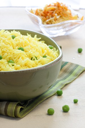 basmati: Saffron flavoured vegetable rice made Indian style. Rice is the long grain basmati variety. Stock Photo