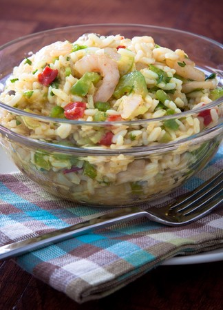 Spicy curry rice mixed with shrimps, celery and herbs. Served as a salad. It can also be served piping hot as there is curry in the bowl. Reklamní fotografie