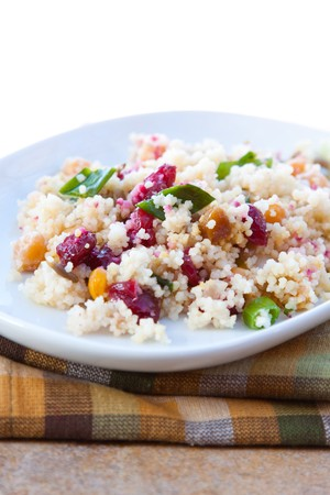 Couscous salad mixed with cranberries, dates, raising, green onions and chickpeas. Topped with dressing made with olive oil, herbs and select spices.
