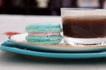 snack: The perfect snack of macaroons with a shot of coffee.