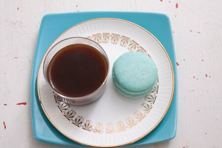 The perfect snack of macaroons with a shot of coffee.