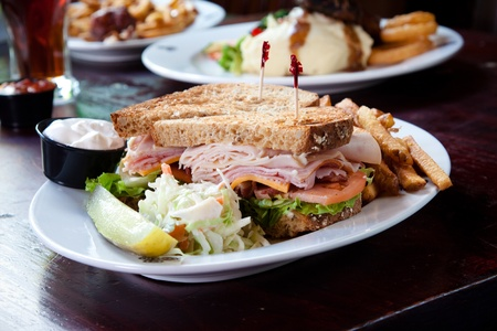 turkey bacon: Smoked turkey, smoked ham, smoked bacon, swiss cheese, cheddar cheese, lettuce, tomato, onion, mayo served on a toasted multigrain bread.