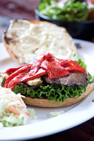 Portobello mushrooms, zucchini, roasted red peppers, red onions and pesto mayo served on focaccia bread. Served with a side of house salad.