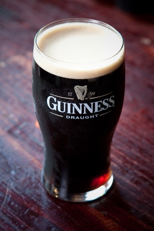 Cold, refreshing pint of Guinness stout Editorial