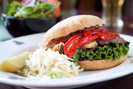 fare: Portobello mushrooms, zucchini, roasted red peppers, red onions and pesto mayo served on focaccia bread. Served with a side of house salad.