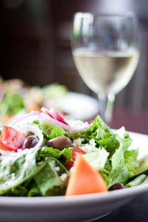 Assorted greens, tomato, cucumber, black olives and Feta cheese are tossed in a traditional Greek dressing. Paired with a glass of white wine.
