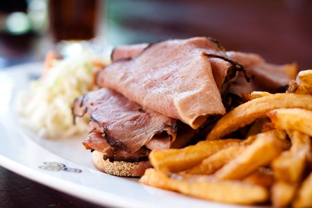 One half pound of steamed and shaved Montreal smoked meat piled high on fresh rye bread. Served with creamy coleslaw, fries and pickle.