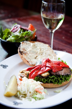 Portobello mushrooms, zucchini, roasted red peppers, red onions and pesto mayo served on focaccia bread. Served with a side of house salad and white wine.